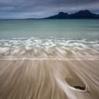 seichte Wellen am Strand