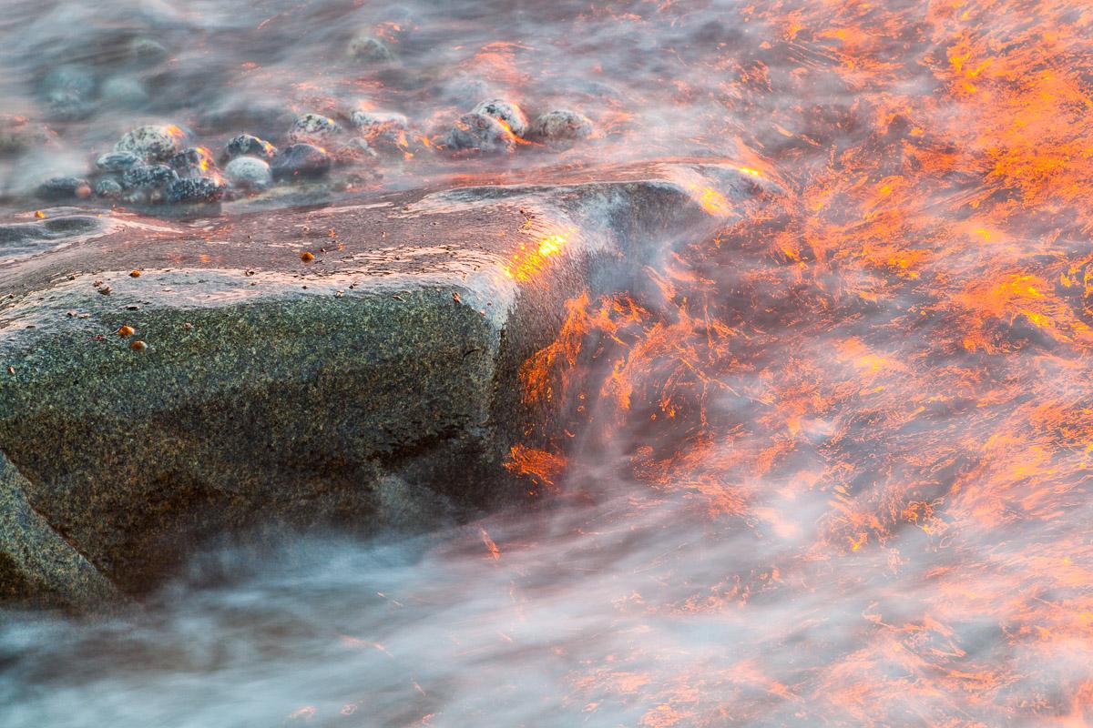 Sonnenuntergang in der Welle, Norwegen